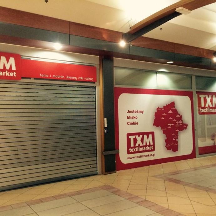 Projekt, produkcja i wyklejanie folii TXM textilmarket w CH Bemowo